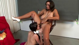 Both dark-haired angels are having enjoyment with one long strap on satisfying it