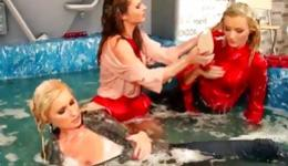 Sultry wenches all fully dressed in Jacuzzi flashing their jugs and acting horny