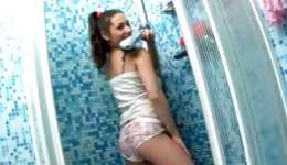 Dark-haired pretty strumpet is showering her exciting unclothes flesh in a baths