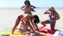 Teen babes are on the beach satisfying sweet solid holes really non-conventional