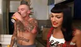 Mischievous brunette on her knees licking this punk dude's a colossal rod