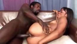 Hot dark-skinned bitch riding a fierce pitch-black cock and gives him a facefucking