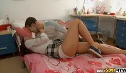 Hot teen aged brown-haired beauty is having fun with her arousing boy