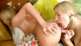 Playful yellowish haired girls are using a pink dildo to pleasure bald holes